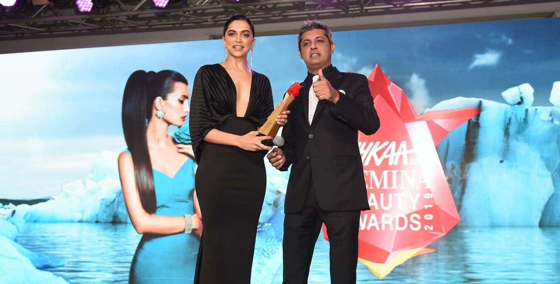 Deepak Lamba, CEO, Worldwide Media, presents Deepika Padukone with the Woman of the Year award