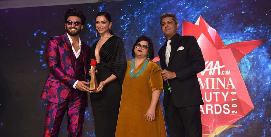 Deepak Lamba, CEO, Worldwide Media and Tanya Chaitanya, CCO and Editor, Femina, award Deepika Padukone and Ranveer Singh with the Beautiful Couple of the Year.