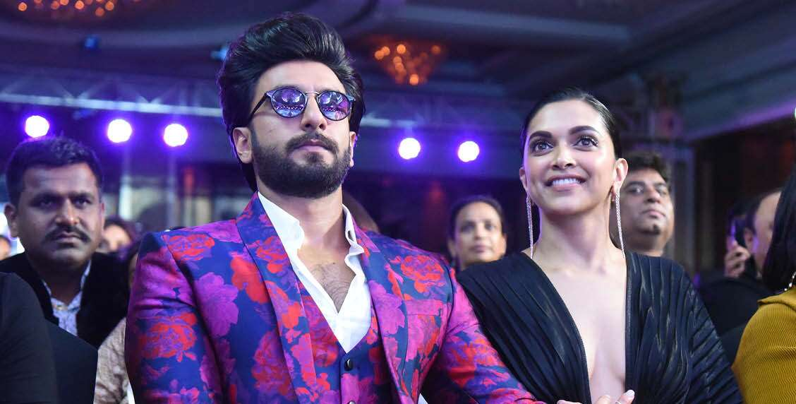 RANVEER SINGH LOOKS DAPPER IN HIS COLOURFUL SUIT WHILE DEEPIKA PADUKONE FLASHES HER PEARLY WHITES