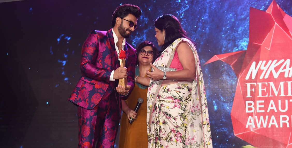 FALGUNI NAYAR, FOUNDER & CEO, NYKAA.COM, AWARDS RANVEER SINGH WITH THE MAN OF THE YEAR AWARD