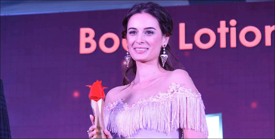 Evelyn Sharma is radiant as she accepts her award