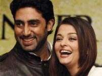 Aishwarya turns stylist for hubby Abhishek