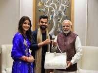 Newly-weds Anushka Sharma and Virat Kohli meet PM Modi