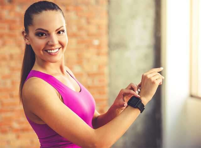 woman with fitness trackers