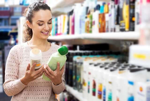Woman checking skincare label