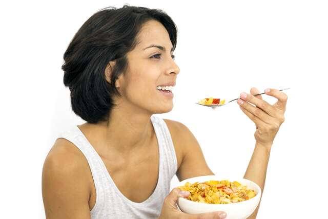 woman eating oats
