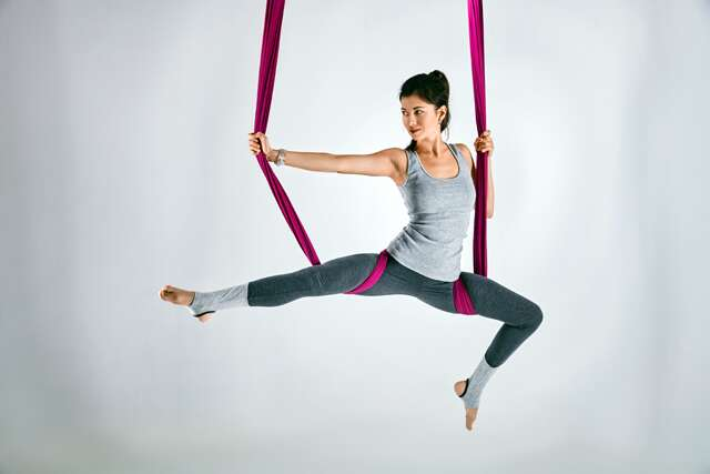woman doing aerial yoga