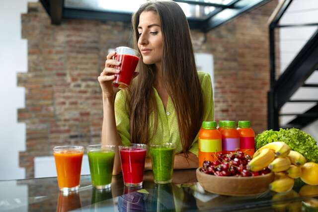 woman drinking juices