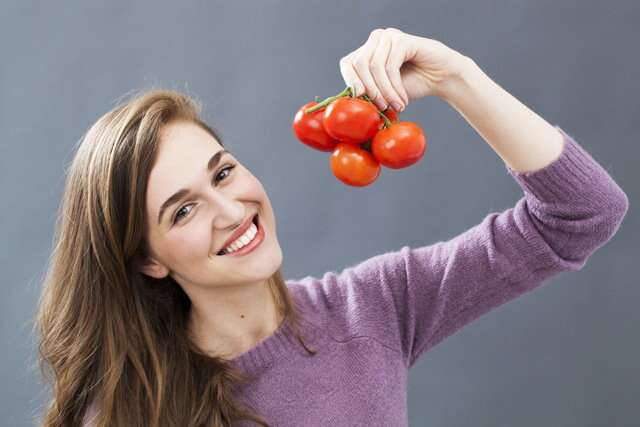 woman and tomatoes