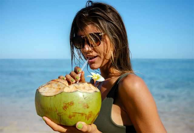 womna drinking coconut water