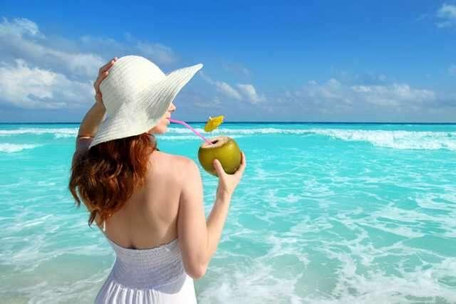 woman drinking coconut waterr
