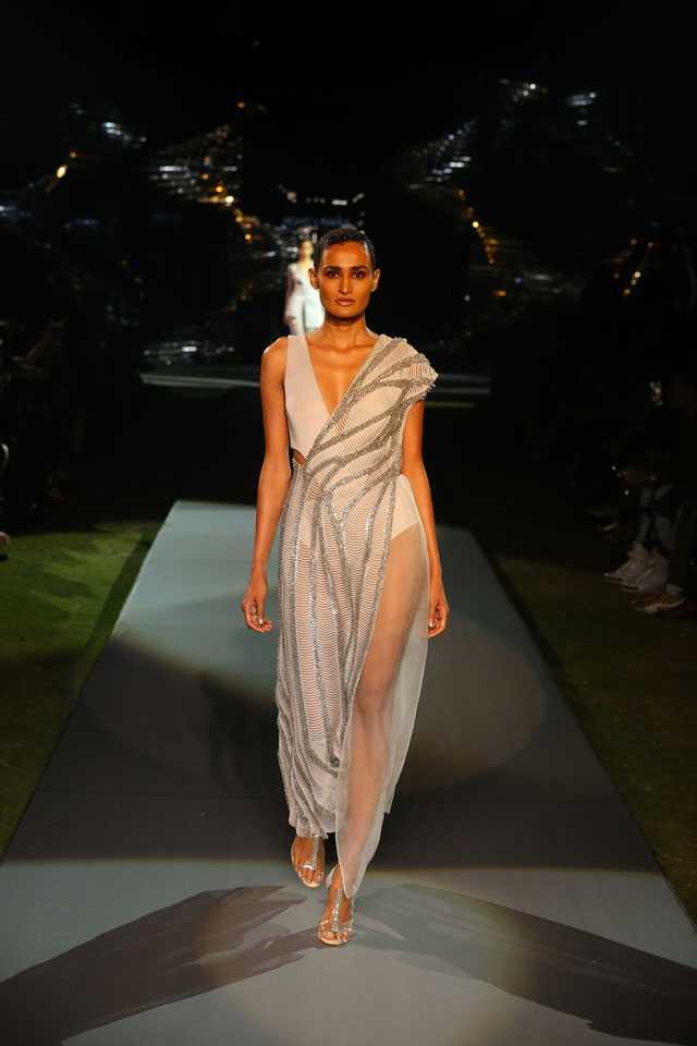 "Master couturiers Rohit Gandhi and Rahul Khanna, who are known for their impeccable cuts, cutting-edge design and a refined, global sensibility, celebrated 20 years in the fashion industry with a presentation of their new AW18 collection, apt called An Evening of Reflections. The show was part of a glittering do attended by the Who's Who of the fashion fraternity, the cream of Delhi's social set, buyers, and the duo's friends and well-wishers. This new line is inspired by Rohit Gandhi + Rahul Khanna's archive pieces, reimagined to fit seamlessly with the trend forecasts of the forthcoming season. The glittering collection played up the duo's strengths and showcased the fine attention to detail that the designers have come to be known for. Commenting on their latest collection, Rohit Gandhi and Rahul Khanna said, ""This collection is extremely close to our hearts, it marks a big milestone in our career. We are thrilled to gain the support of friends and family throughout this journey. We have seen fashion grow and are proud to have contributed to the industry. We have used techniques, silhouettes and designs that together create a perfect combination of mystery and glamour. It is a great feeling to see this collection come alive in such a mesmerizing way.""  Pic 1 Glistening silver detailing adds a touch of elegance to every garment   Pic 2 The line was marked by a predominance of metallic hues with modern edgy elements  Pic 3 Old world glamour and mystery in a classic silhouette with contemporary touches    Pic 4 Feminine, luxurious fabrics like frosted silks add fluidity to the outfits  Pic 5 The colours palette is mostly silver and metallic with a hint of crystalline blue  Pic 6 Thigh-high cuts and plunging necklines to smoulder your way through AW18  Pic 7 Each garment is painstakingly handcrafted to bring detailing like appliqué work, laser cut work and hand-beading to life.   Pic 8 Shimmer, shine and sheer touches infuse tonnes of oomph in this metallic-grey ensemble  Pic 9 Fine-grained tulle and sheer organza creates an air of refined luxury and femininity"