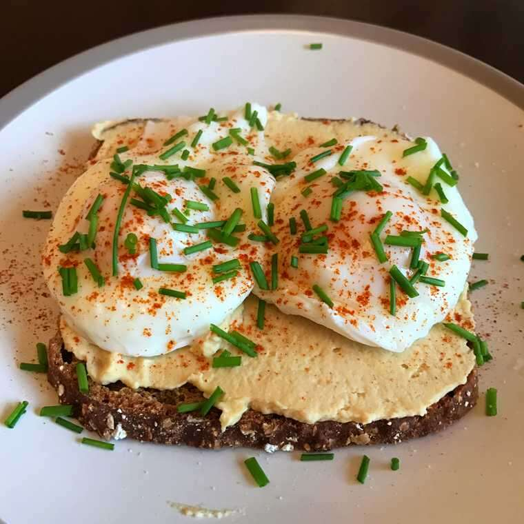 Hummus and poached eggs on toast