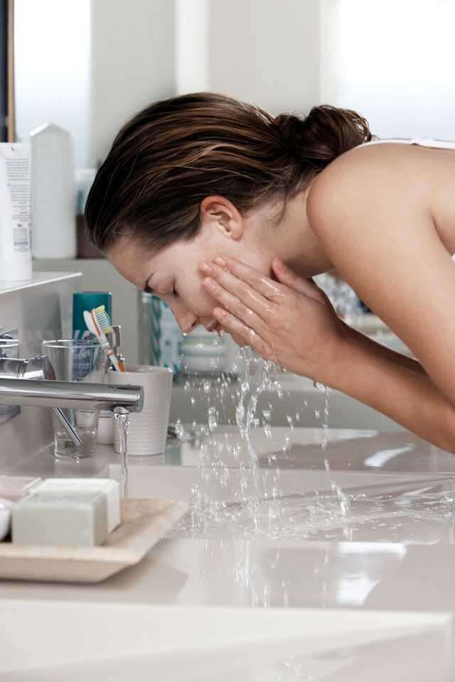Wash face with lukewarm water