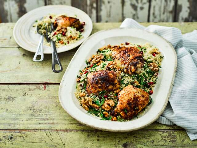 Pomegranate glazed chicken  with walnuts and pomegranate couscous