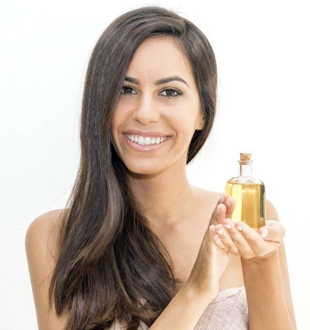 Apply an almond paste or almond oil to the hair for Straighten Hair Naturally