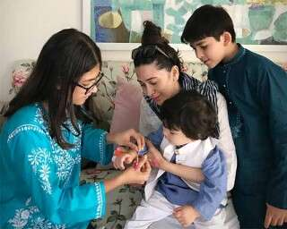 Aren't these pics of Karisma Kapoor and nephew Taimur Ali Khan adorable?