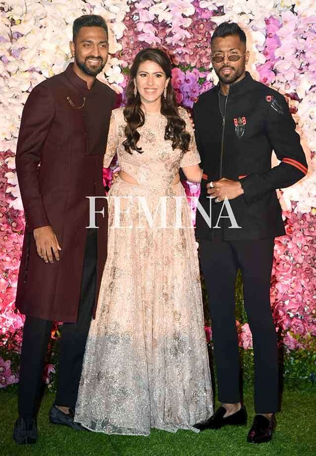 Cricketer Krunal Pandya with wife and brother, cricketer Hardik Pandya