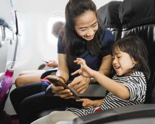 How to survive long flights with your kids