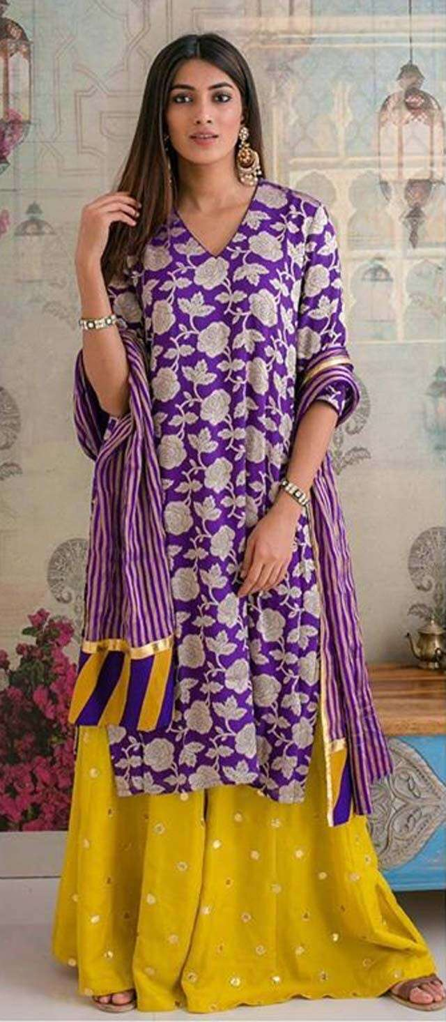 Purple jaal kurta and yellow sharara by Heli Shah Label