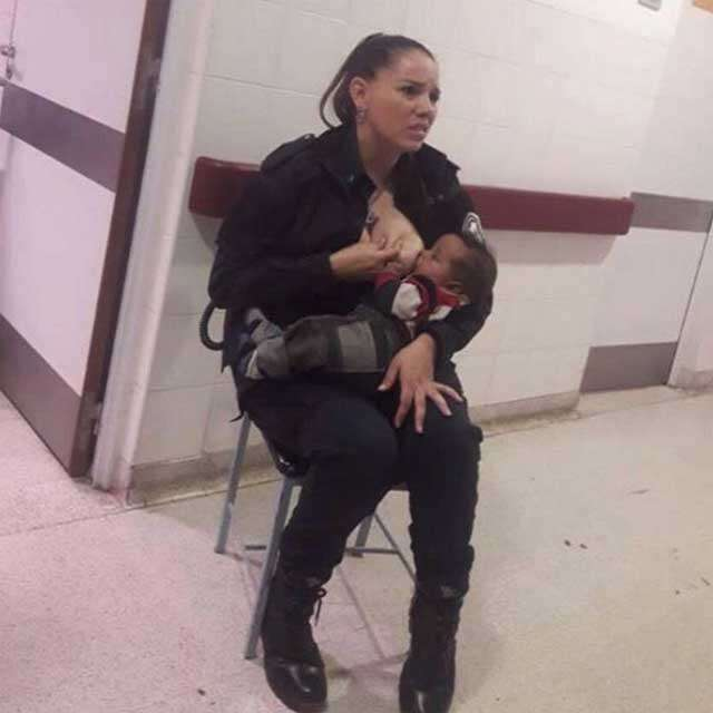 Argentinian Police officer breastfeeding a malnourished baby