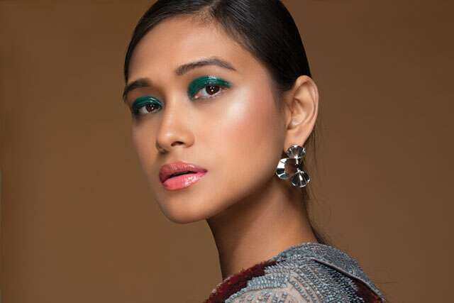Glam up with glossy eyeshadow and lipstick