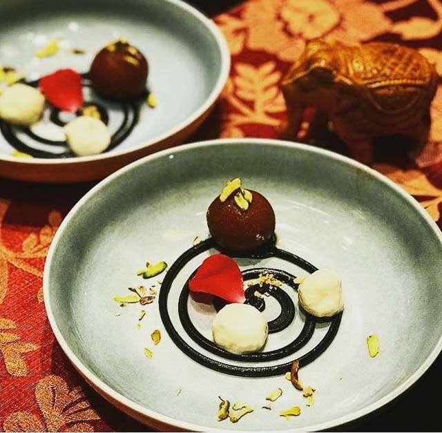 Chocolate gulab jamun with vanilla rasgulla