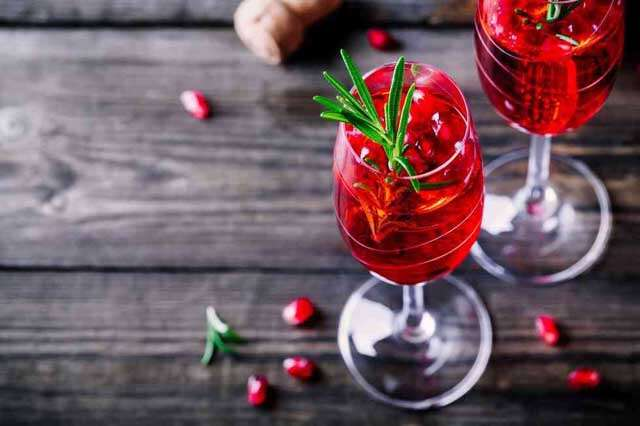 Make easy mocktail with pomegranate and orange