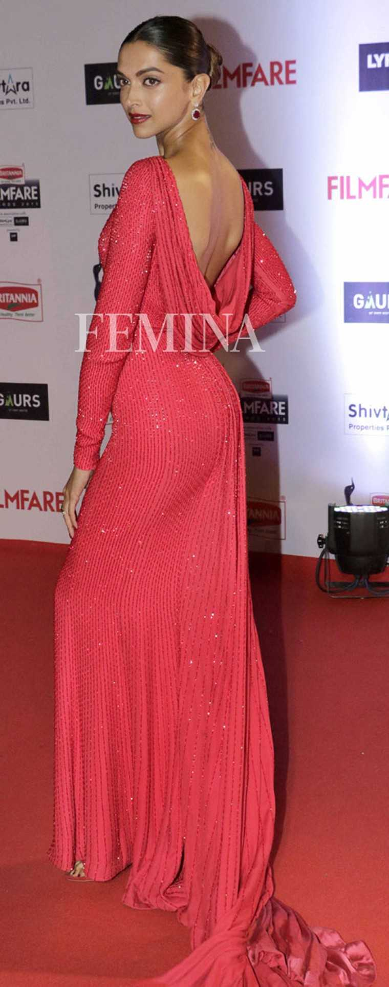 Deepika Padukone accepted her Filmfare award in a shimmering red draped-back gown by Ralph and Russo. She kept the rest of her look fuss-free with a sleek updo and classic drop earrings.