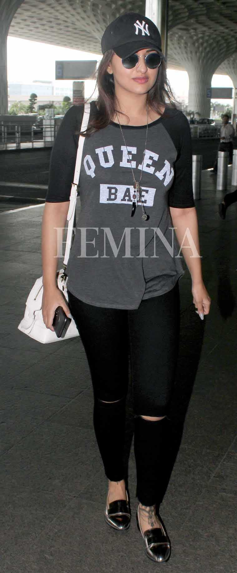 Sonakshi Sinha tries the slogan trend in a sassy tee paired with ripped denims and a baseball cap.