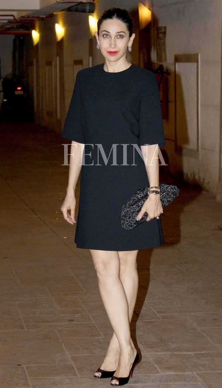 Karisma Kapoor charms us in her Alexander McQueen shift dress paired with glossy peep-toes and a slouchy Chanel clutch.