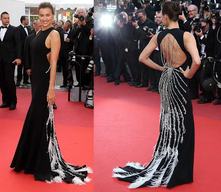 Supermodel Irina Shayk dazzled on the Cannes 2016 red carpet in a monochrome Miu Miu gown. The diamanté and feather detailing on the back of the gown ensured that she stayed in the spotlight all through.