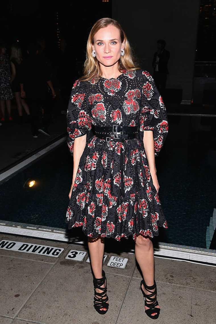 The newly single Diane Kruger wore a poppy print broderie anglaise dress by Alexander McQueen with Chopard earrings at the screening of her new film Disorder.  We love the addition of that grungy belt.