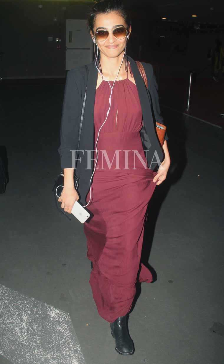 Radhika Apte accessorises her blazer and maxi ensemble with ombré aviators and chunky boots.