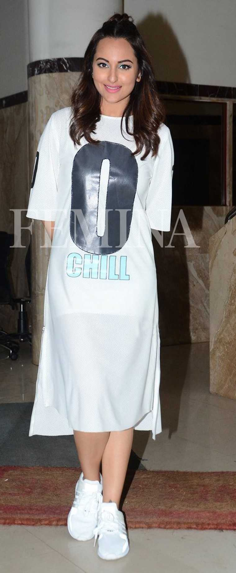 Athleisure features high on Sonakshi's style arsenal. In this case, she steps out in an easy T-Shirt dress by Kanika Goyal paired with a half-bun and sneakers.