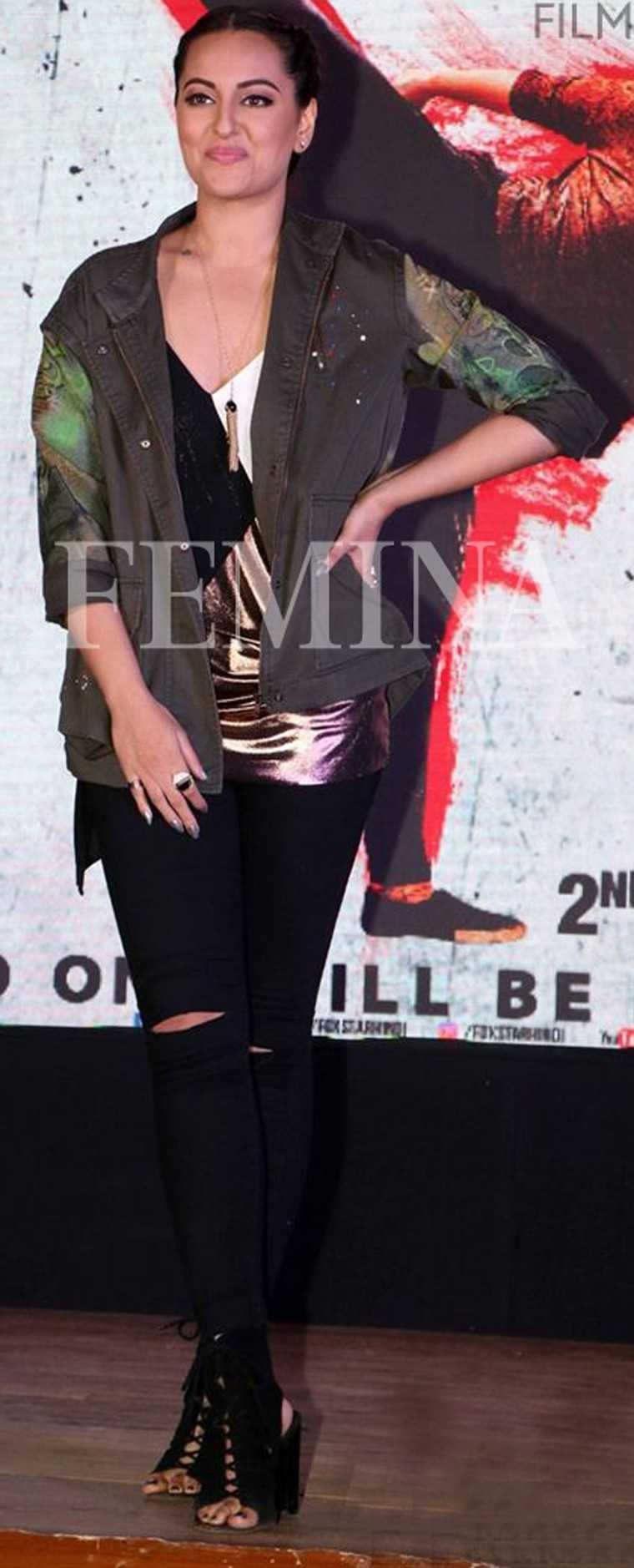 Sonakshi looks badass in her graffiti-style military jacket over denims and a tee. Boxer braids and a pair of lace-up sandals add the finishing touches.