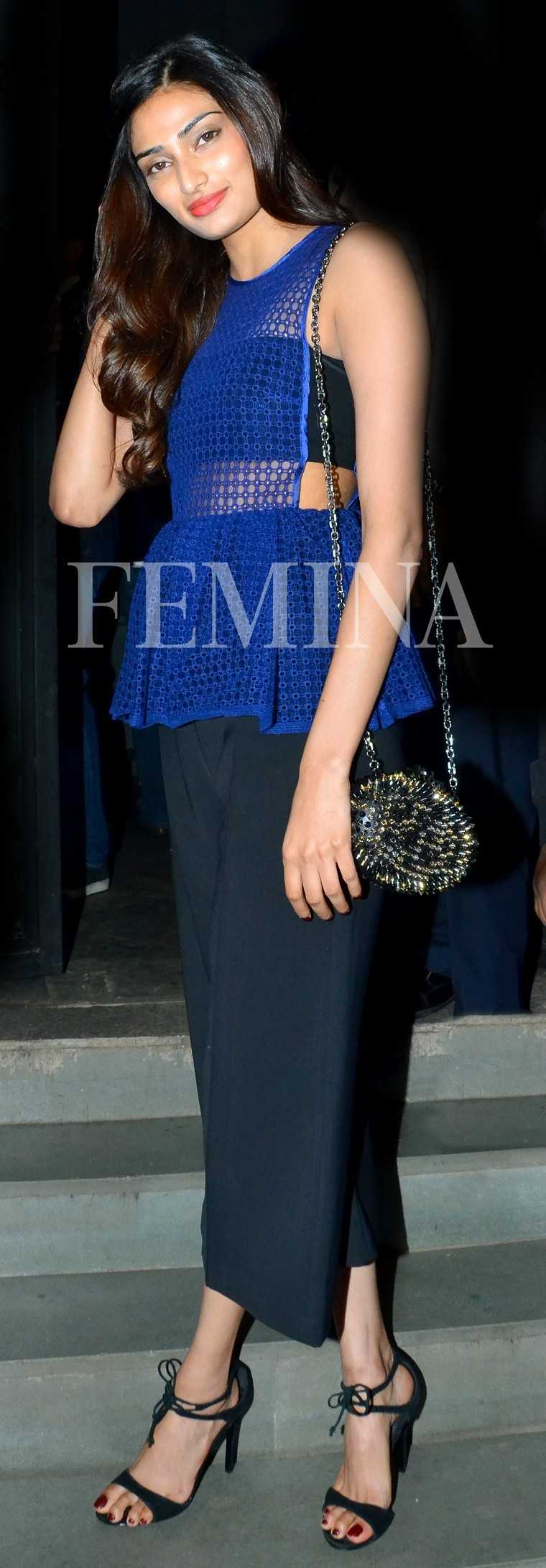 Athiya Shetty Athiya takes her culottes for a night out in this Self-Portrait outfit teamed with a Christian Louboutin bag and ankle-strap sandals.