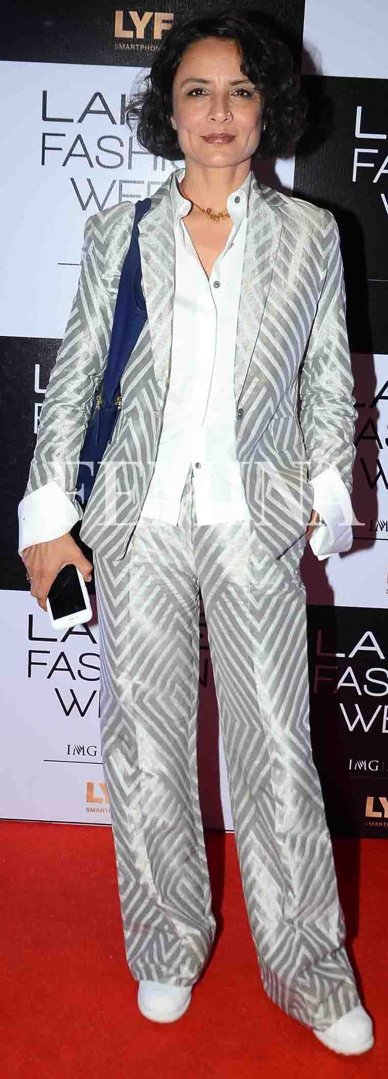 ADHUNA AKHTAR: The celebrity hairstylist wore a killer silver suit by Payal Khandwala for the designer's fashion show. We love the straight fit of the trousers and the way she paired it all with a pair of white sneakers.