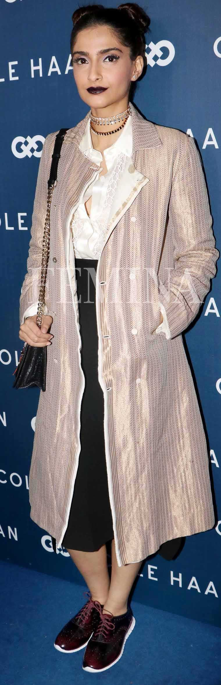 SONAM KAPOOR: The actor was recently spotted wearing a white Bibhu Mohapatra shirt under a gold Pero coat. While the look was quite luxe, Cole Haan sneakers and a goth makeup look kept things casual.