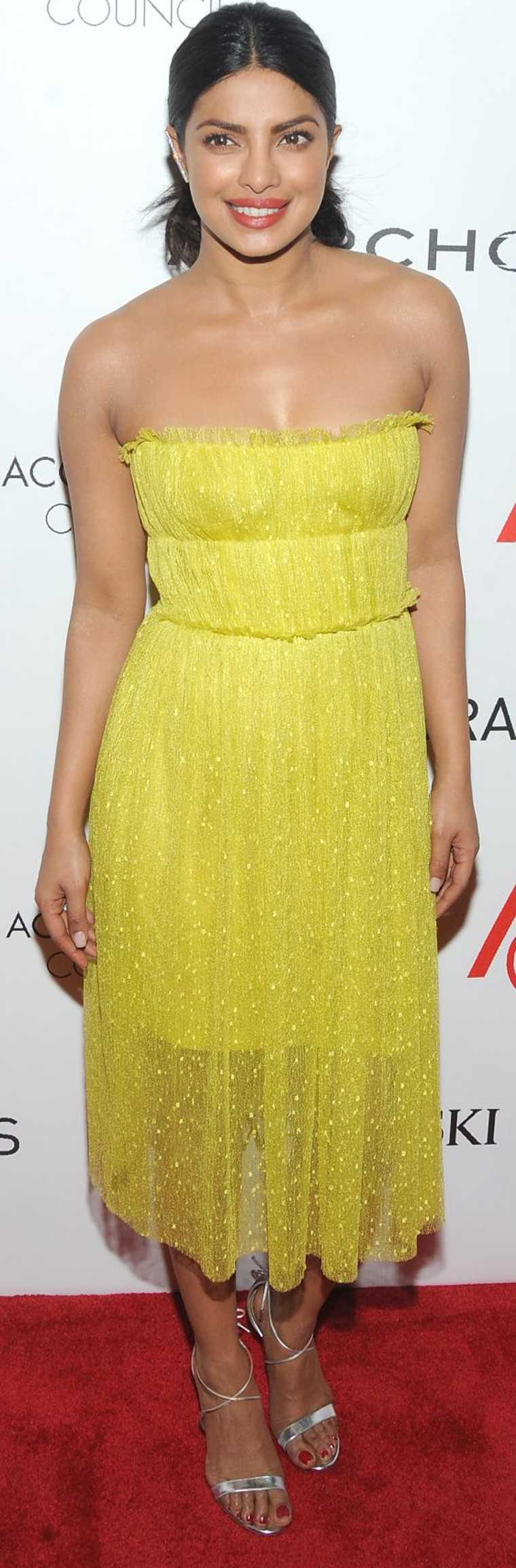 PRIYANKA CHOPRA: Always on trend, Priyanka recently sported this lime yellow Jason Wu frock. Pulled back hair, strappy silver stilettos and a red lip ensured she looked glamorous as well as pretty.