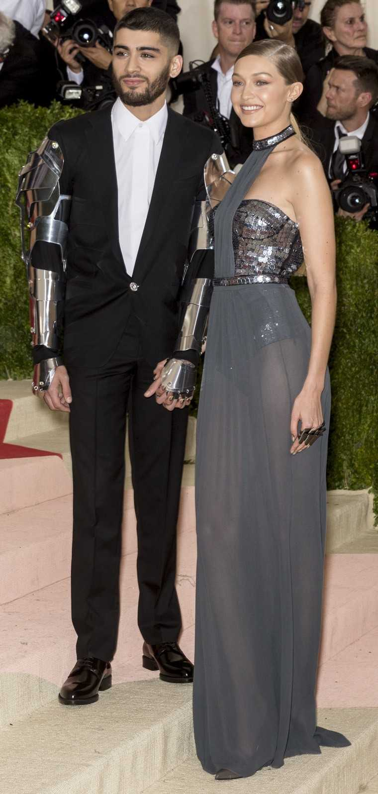 Zayn Malik and Gigi Hadid: A pop star and a supermodel—the result could only be dynamite. The pretty young things took the dress code of this year's Met Gala 2016 to heart with Zayn covering his Versace tux sleeves in metallic armour and Gigi opting f