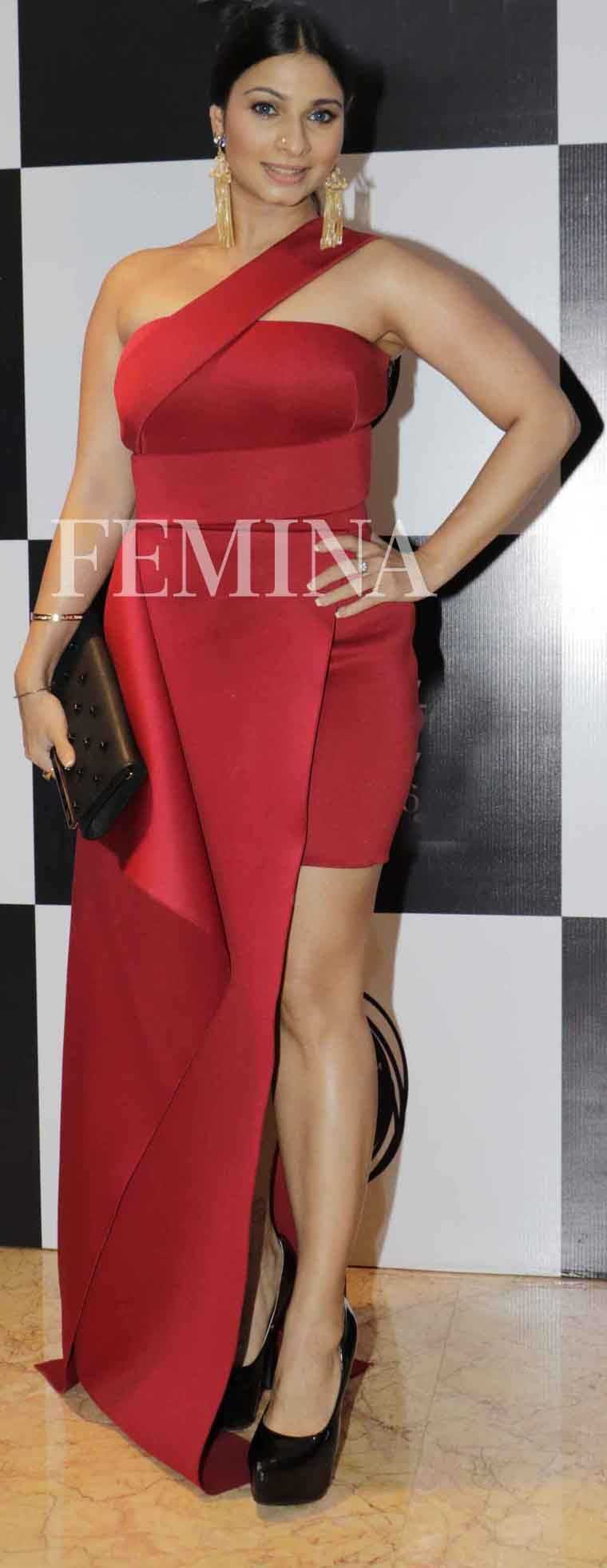 TANISHAA MUKERJI If pillar-box red is too bright for you, take your cue from Tanishaa and opt for a shade that veers more towards rust. This Gauri & Nainika number with a fitted skirt and flowing overlay let Tanishaa show off every curve.
