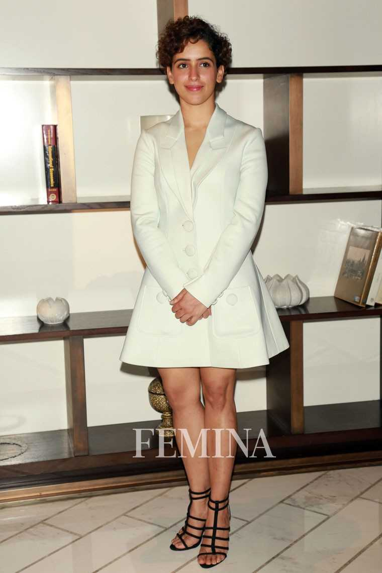 Sanya Malhotra white flared-hem blazer, worn as dress, paired with black sandals.