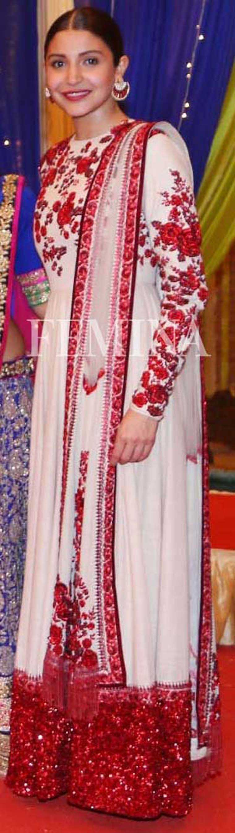 Anushka Sharma For Sultan promotions, Anushka chose an elegant Sabyasachi anarkali. Hair pulled back in slick bun, she finished her look with ruby earrings by Curio Cottage.
