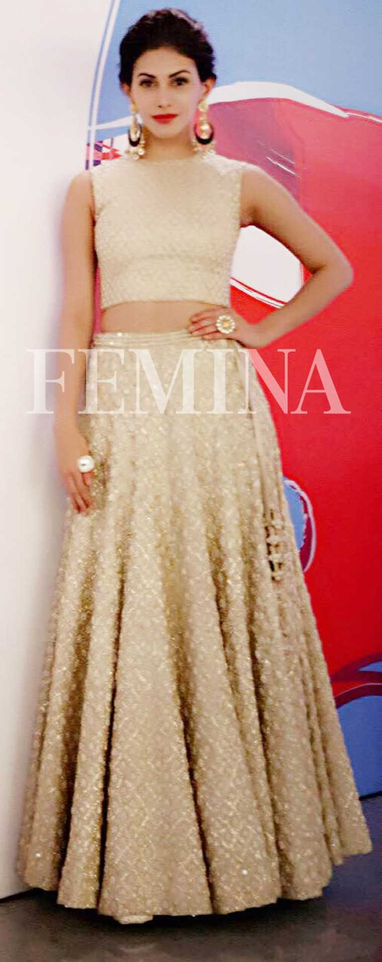 Amyra Dastur: Eggnog  We love Amyra's richly embellished lehenga choli. She dresses it up with a red lip and an elegant updo.