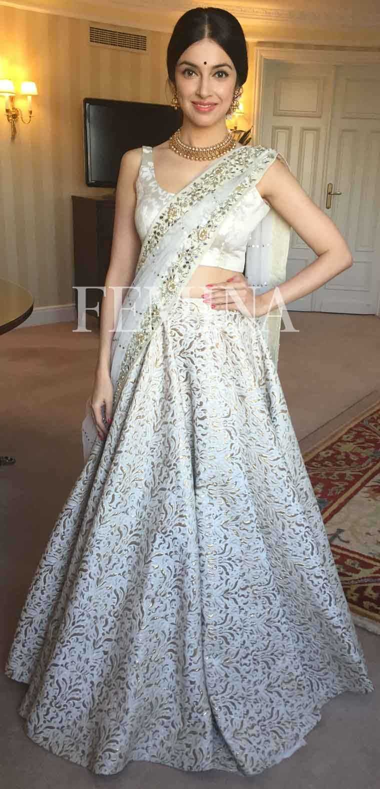 Divya Khosla Kumar: Ivory Divya went for an ornate Vikram Phadnis lehenga for her appearance at a recent award show. She finishes her look with a bindi, traditional gold jewellery and flowers in her hair.