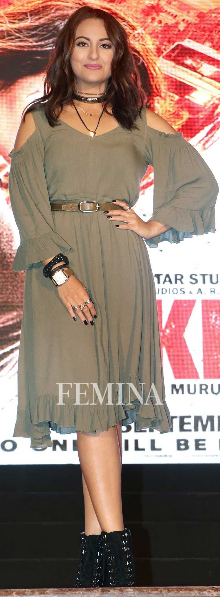 SONAKSHI SINHA While the khaki colour of her Koovs dress says utilitarian says, the ruffled hem, lantern sleeves and addition of a skinny choker are more appropriate for brunch rather than safari-ready.