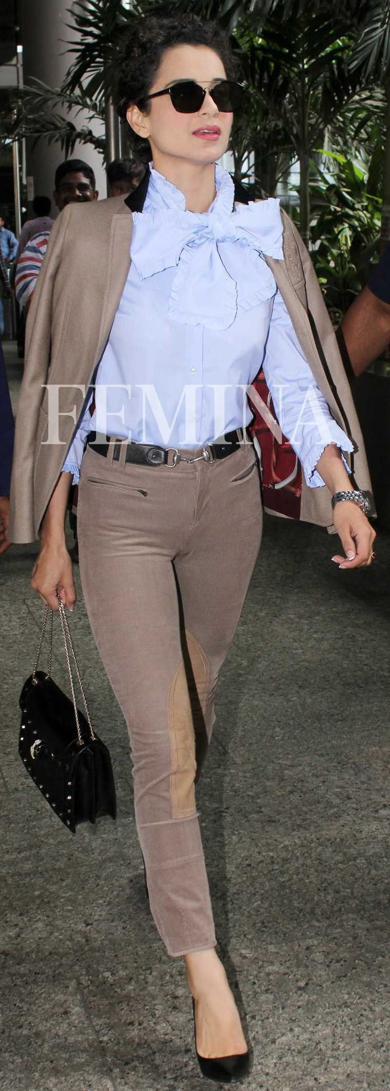 Kangana Ranaut adds a feminine touch to her Gucci pantsuit with a pussy-bow blouse.