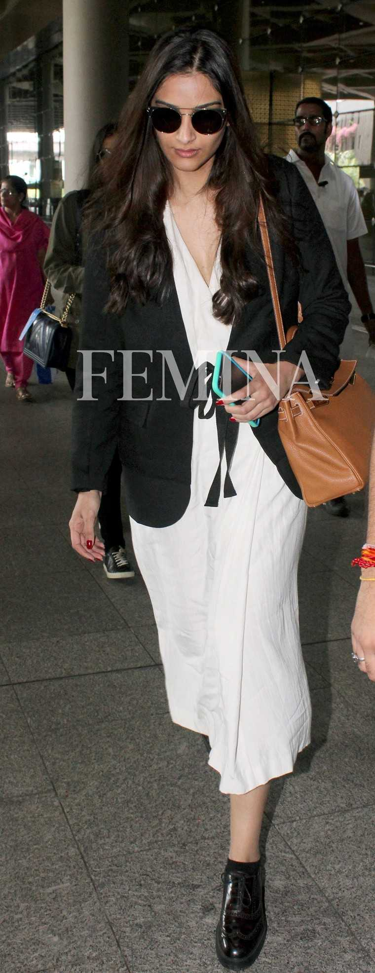 Sonam Kapoor keeps it sharp and simple in monochrome separates from Bodice. She breaks her look with a tan sling.
