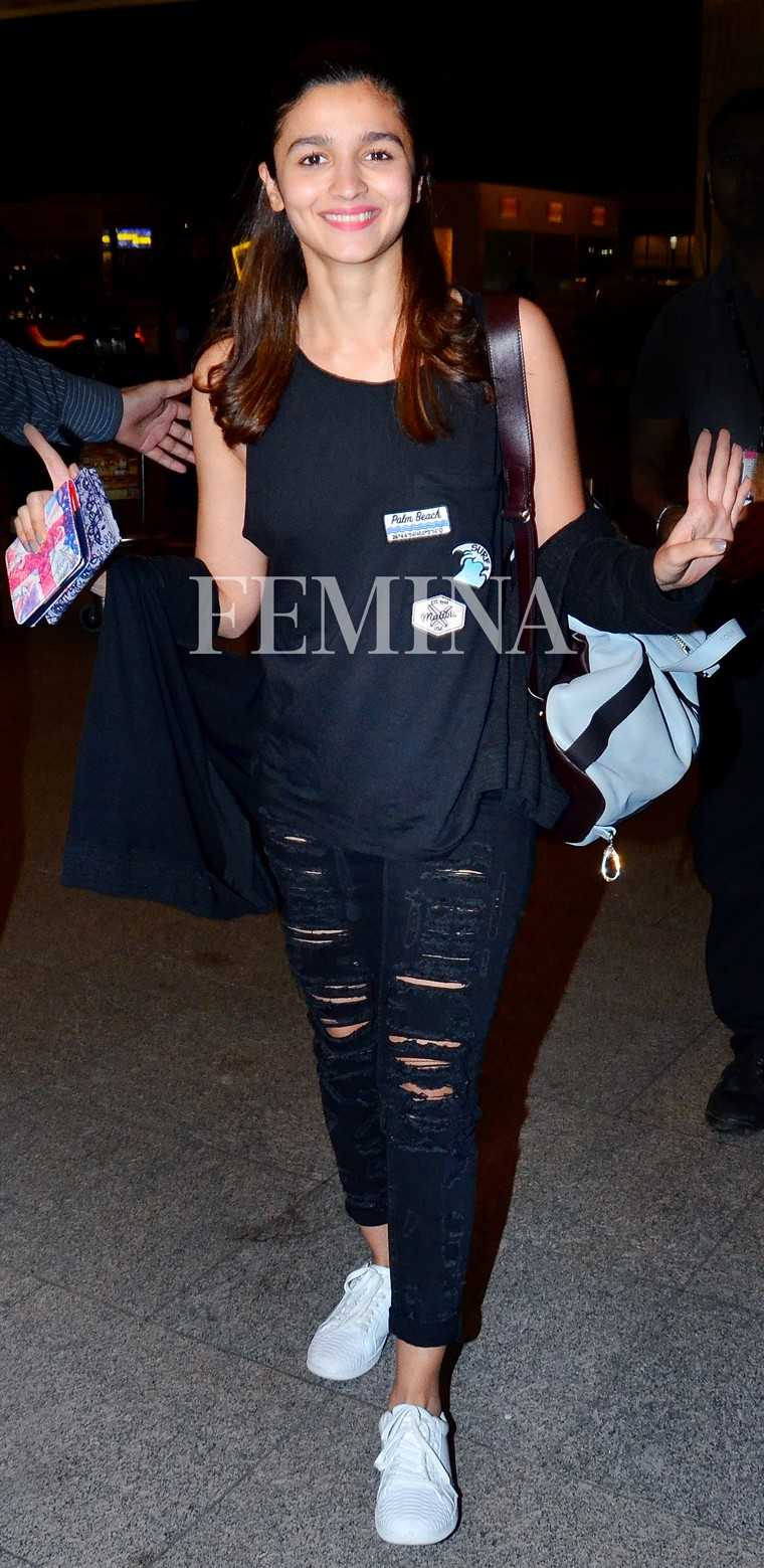 ALIA BHATT The adorable baby blue colour of Alia's Poem backpack puts it on top of our wishlist. We love how it added a dose of freshness to her head-to-toe black travel gear.